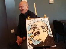 Karikaturist-tekent-lachende-man