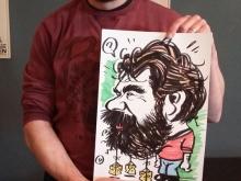 Karikaturist tekent man met baard